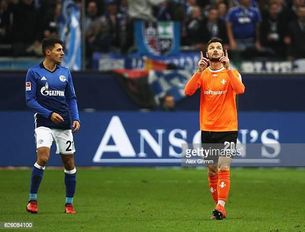 Marcel Heller of SV Darmstadt 98 celebrates after scoring the first goal during the Bundesliga match between FC Schalke 04 and SV Darmstadt 98 at...