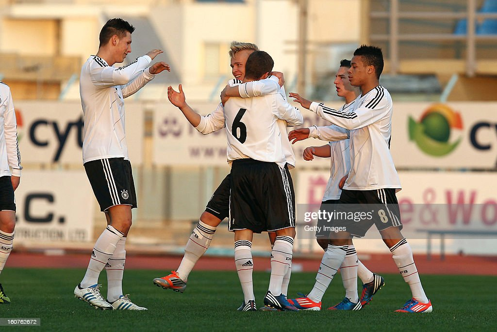 Marcel Hilssner (C) of Germany celebrates his team's first goal with his team mates during the international friendly match between U18 Cyprus and U18 Germany at Stadio Tasos Markou on February 5, 2013 in Paralimni, Cyprus.