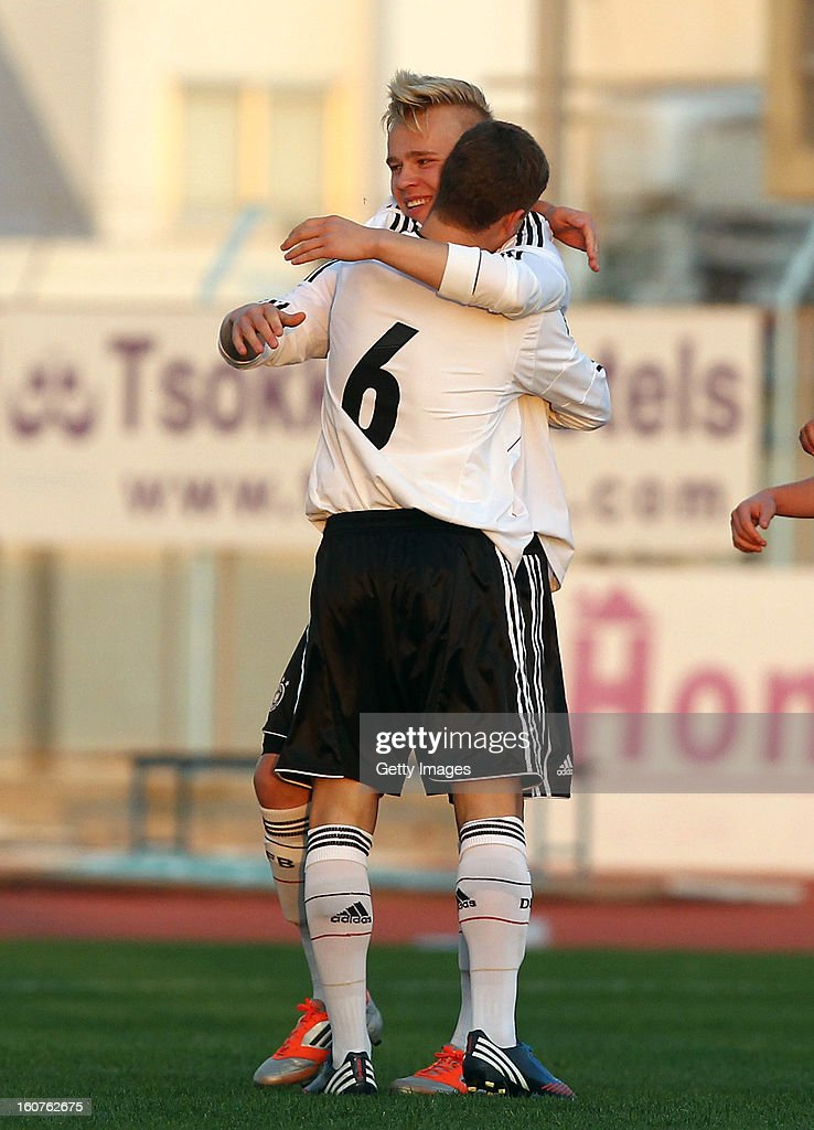 Marcel Hilssner of Germany celebrates with his team mate Joshua Kimmich after scoring his team's first goal on during the international friendly match between U18 Cyprus and U18 Germany at Stadio Tasos Markou on February 5, 2013 in Paralimni, Cyprus.