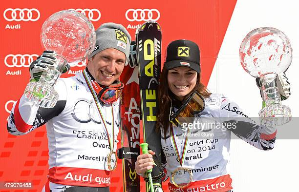 Marcel Hirscher and Anna Fenninger of Austria pose with the crystal globes for the overall title at the Audi FIS Alpine Skiing World Cup Finals on...