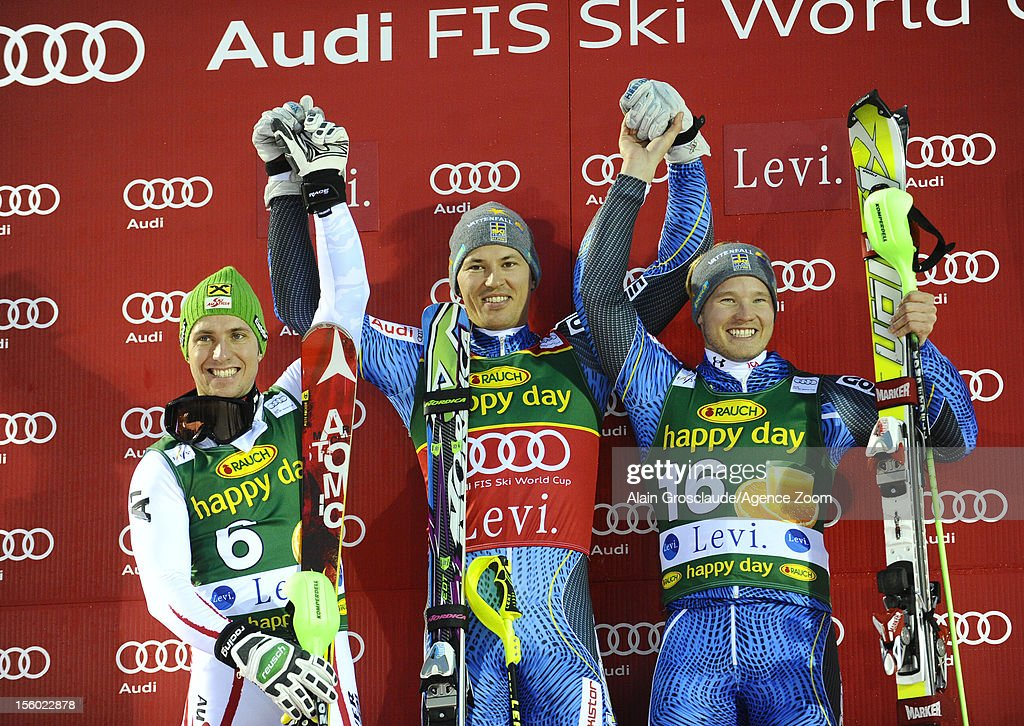 Marcel Hirscher , Andre Myhrer, Jens Byggmark on the podium during the Audi FIS Alpine Ski World Cup Men's Slalom on November 11, 2012 in Levi, Finland.