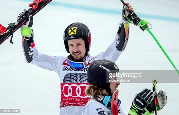 Marcel Hirscher from Austria cheers after winning the giant slalom competition of the FIS Alpine Ski World Cup in GarmischPartenkirchen Germany 28...