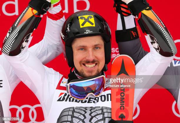 Marcel Hirscher from Austria cheers during the award ceremony of the giant slalom competition at the FIS Alpine Ski World Cup in...