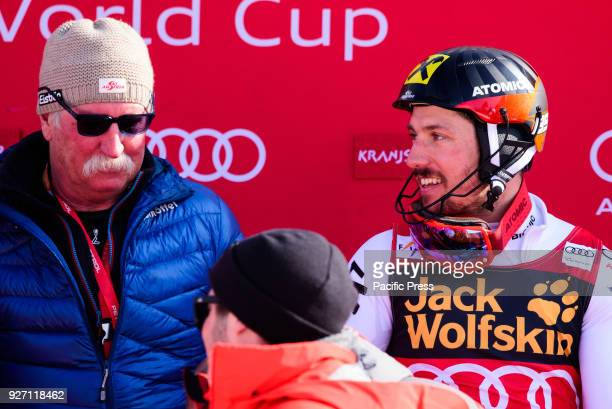 Marcel Hirscher of Austria and his father celbrating first place at overall World Cup victory of Big Crystal Globe in season 2017/2018