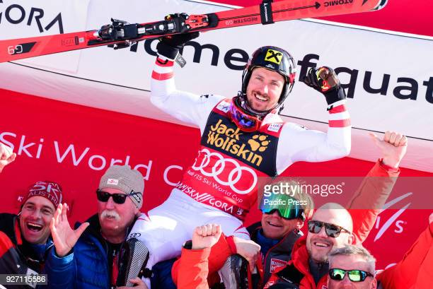 Marcel Hirscher of Austria celbrating with his team his first place at overall World Cup victory of Big Crystal Globe in season 2017/2018