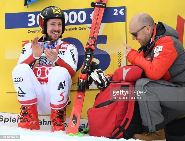Marcel Hirscher of Austria celebrates victory after the men's Giant Slalom at the FIS Alpine Skiing World Cup in GarmischPartenkirchen southern...