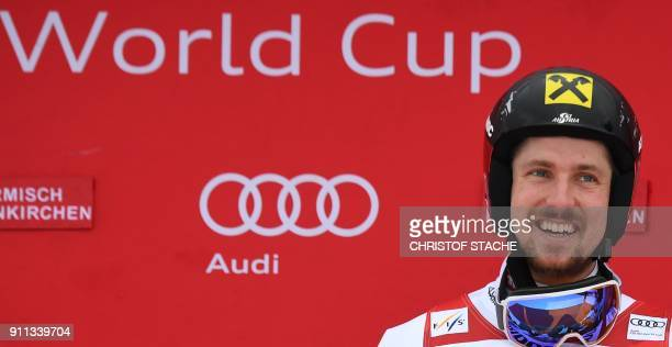 Marcel Hirscher of Austria celebrates victory on the podium after the men's Giant Slalom at the FIS Alpine Skiing World Cup in GarmischPartenkirchen...