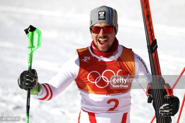 Marcel Hirscher of Austria celebrates winning gold at the finish during the Men's Alpine Combined Slalom on day four of the PyeongChang 2018 Winter...
