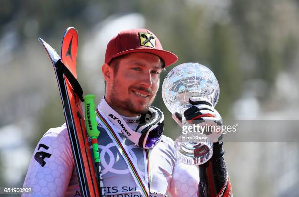 Marcel Hirscher of Austria celebrates with his globe for winning the season title for the men's Giant Slalom during the 2017 Audi FIS Ski World Cup...