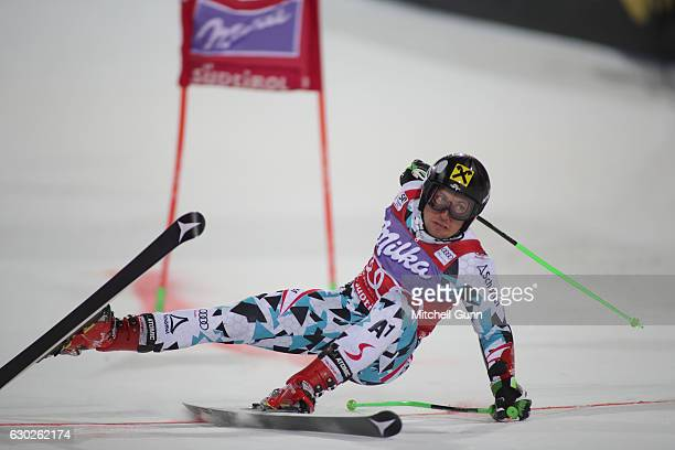 Marcel Hirscher of Austria crashes out during the Audi FIS Alpine Ski World Cup Men's Parallel Giant Slalom race on December 19 2016 at Alta Badia...