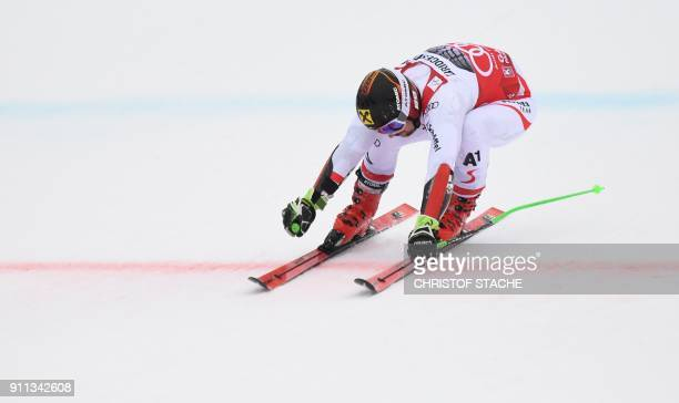 Marcel Hirscher of Austria crosses the finish line to win the men's Giant Slalom at the FIS Alpine Skiing World Cup in GarmischPartenkirchen southern...