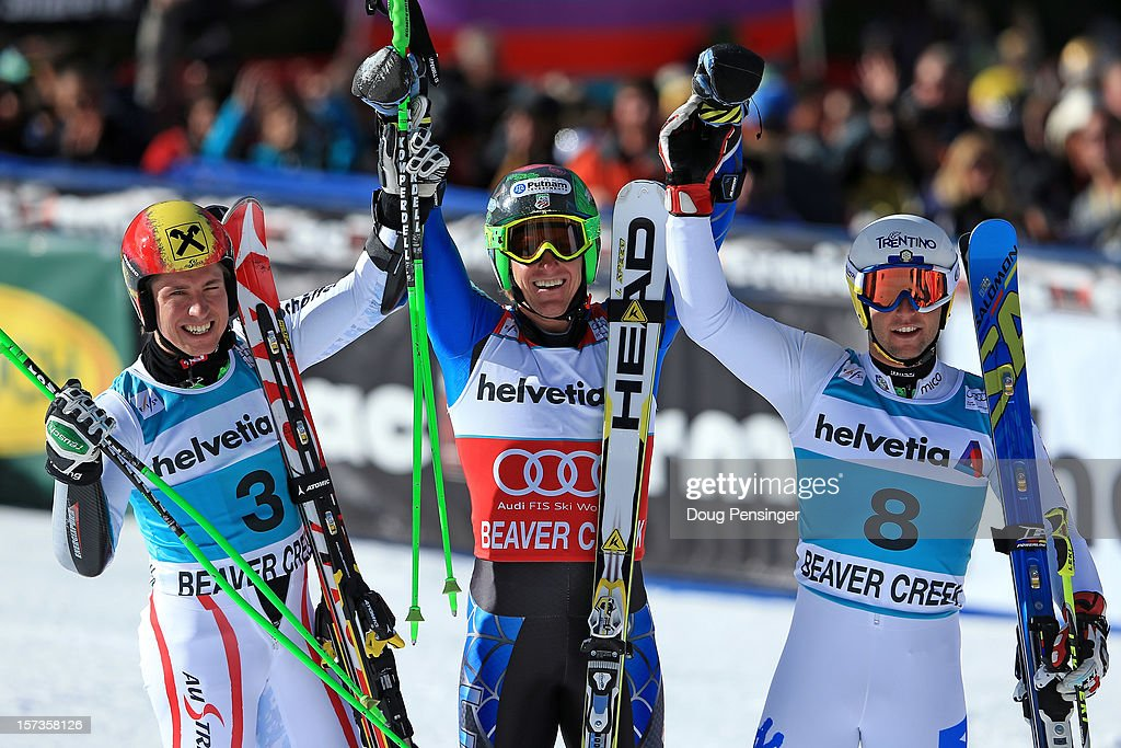 Marcel Hirscher of Austria in second place,Ted Ligety of the USA in first place and Davide Simoncelli of Italy in third place pose for a photo following the men's Giant Slalom at the Audi FIS World Cup on December 2, 2012 in Beaver Creek, Colorado.