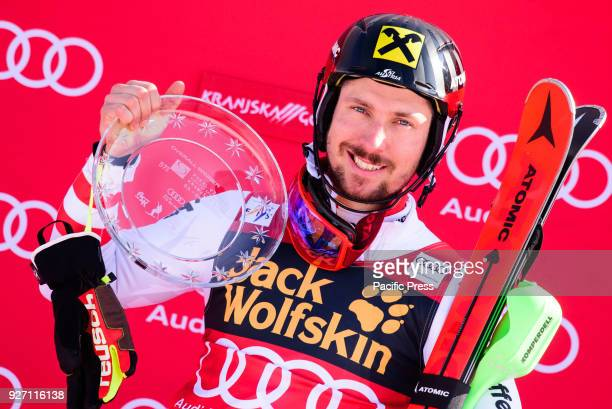 Marcel Hirscher of Austria on podium celbrating his first place at the Slalom race at the Vitranc Cup FIS World Cup and overall World Cup victory of...