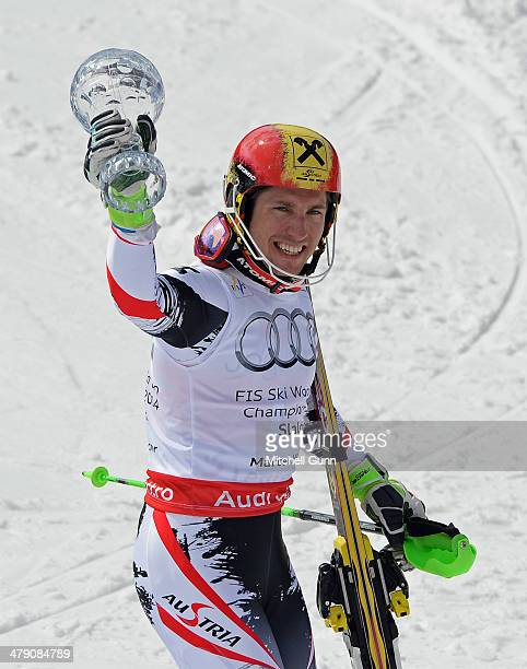 Marcel Hirscher of Austria poses with the crystal globe for the overall title in the Audi FIS Alpine Skiing World Cup Finals Slalom on March 16 2014...