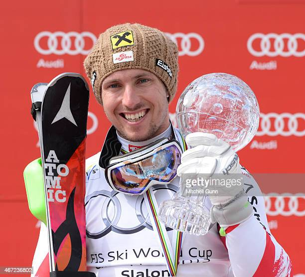 Marcel Hirscher of Austria poses with the crystal globe for the overall slalom title after the FIS Alpine Ski World Cup men's slalom race on March 22...