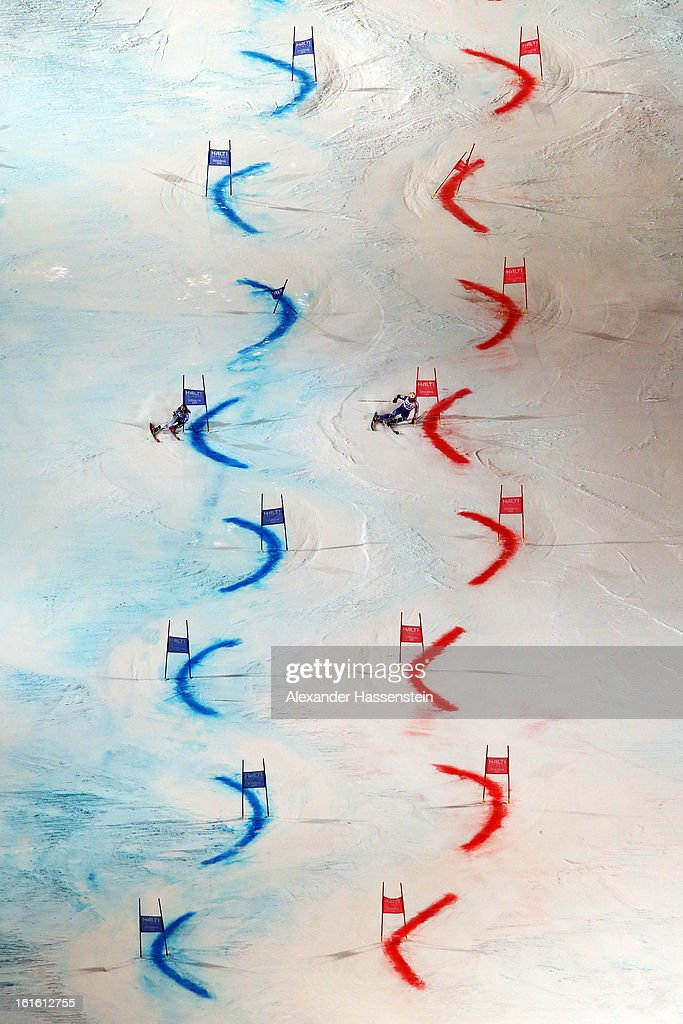 Marcel Hirscher (L) of Austria races against Mattias Hargin (R) of Sweden in the final of the Men and Women's Nations Team Event during the Alpine FIS Ski World Championships on February 12, 2013 in Schladming, Austria.
