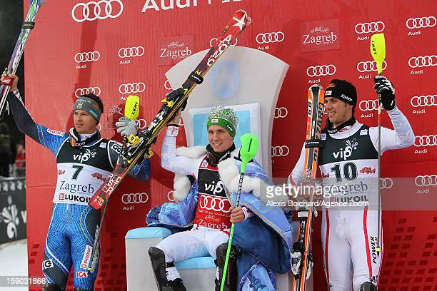 Marcel Hirscher of Austria takes 1st place Andre Myhrer of Sweden takes 2nd place and Mario Matt of Austria takes 3rd place during the Audi FIS...