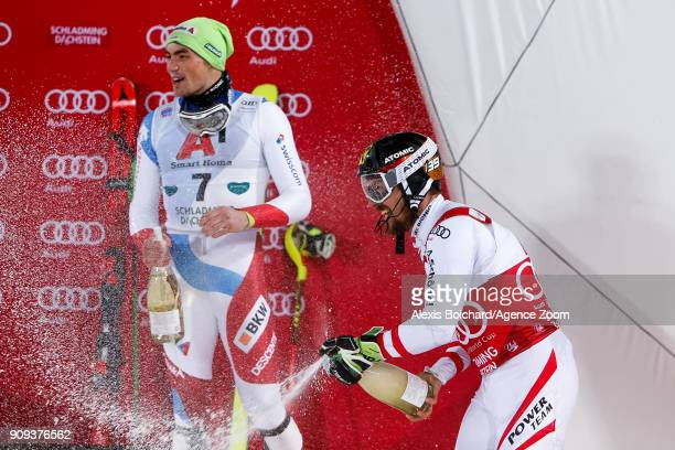 Marcel Hirscher of Austria takes 1st place Daniel Yule of Switzerland takes 3rd place during the Audi FIS Alpine Ski World Cup Men's Slalom on...