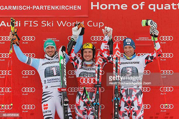 Marcel Hirscher of Austria takes 1st place Felix Neureuther of Germany takes 2nd place Benjamin Raich of Austria takes 3rd place during the Audi FIS...