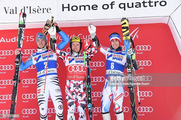 Marcel Hirscher of Austria takes 1st place Felix Neureuther of Germany takes 2nd place Victor Muffat Jeandet of France takes 3rd place during the...