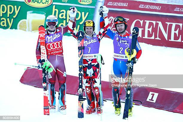 Marcel Hirscher of Austria takes 1st place Henrik Kristoffersen of Norway takes 2nd place Alexandr Horoshilov of Russia takes 3rd place during the...