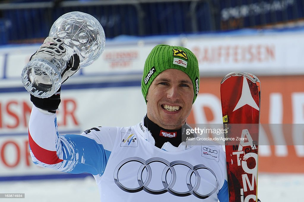 Marcel Hirscher of Austria takes the globe for the overall World Cup Slalom during the Audi FIS Alpine Ski World Cup Men's Slalom on March 17, 2013 in Lenzerheide, Switzerland.
