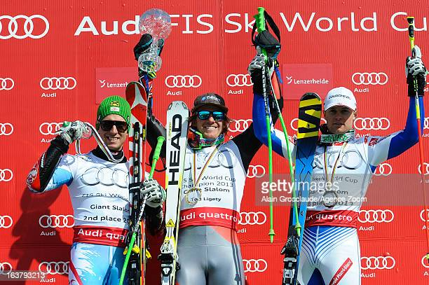 Marcel Hirscher of Austria Ted Ligety of USA and Alexis Pinturault of France pose on the podium after the Audi FIS Alpine Ski World Cup Men's Giant...