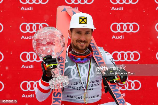 Marcel Hirscher of Austria wins the globe in the overall standings during the Audi FIS Alpine Ski World Cup Finals Men's Slalom on March 18 2018 in...