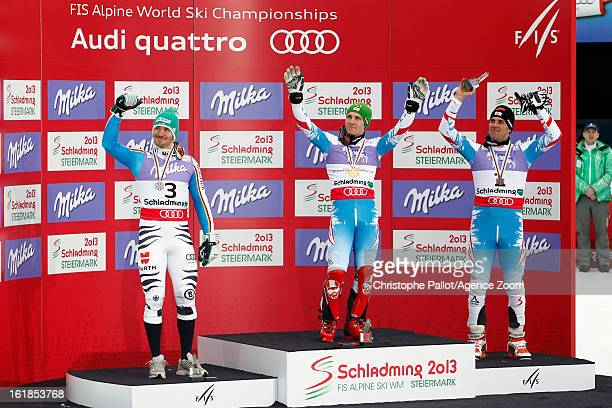 Marcel Hirscher of Austria wins the gold medal Felix Neureuther of Germany wins the silver medal Mario Matt of Austria wins the bronze medal during...
