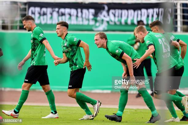 Marcel Hoffmeier of Muenster celebrates the first goal with his team mates during the DFB Cup first round match between Preußen Münster and VfL...
