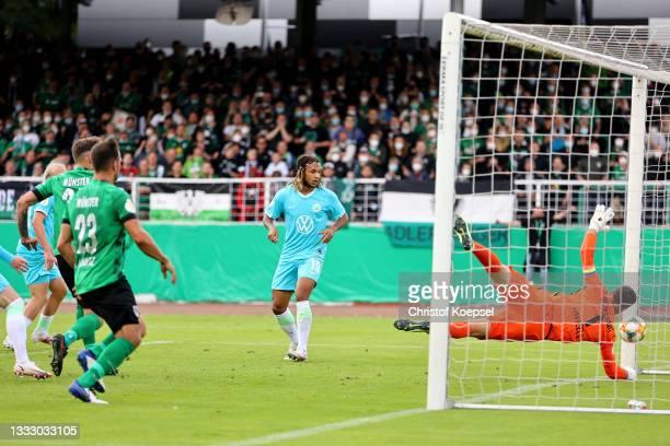 Marcel Hoffmeier of Muenster scores the first goal during the DFB Cup first round match between Preußen Münster and VfL Wolfsburg at Preussen Stadion...