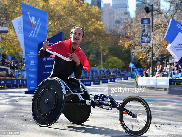 Marcel Hug of Switzerland celebrates after finishing first in the Professional Wheelchair Men's Division during the 2016 TCS New York City Marathon...