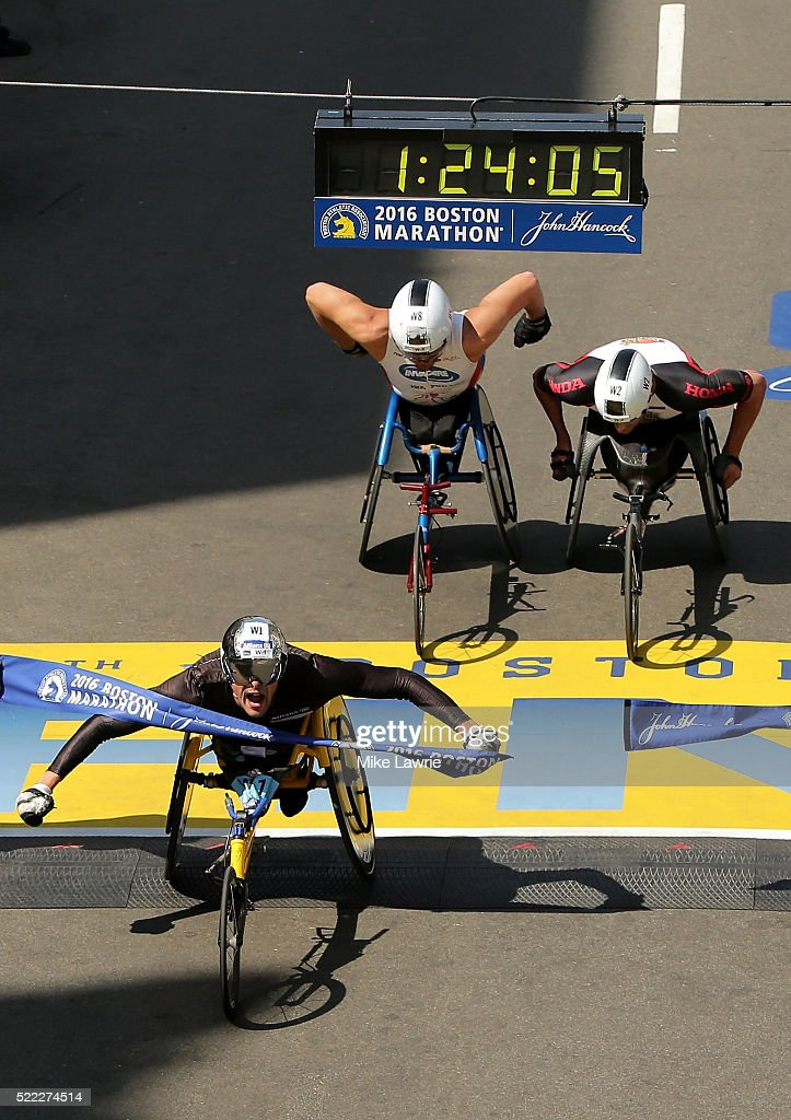 Marcel Hug of Switzerland celebrates as he crosses the finish line to win the men's push rim wheelchair race ahead of Kurt Fearnley of Australia and Ernst Van Dyk of South Africa during the 120th Boston Marathon on April 18, 2016 in Boston, Massachusetts.