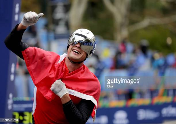 Marcel Hug of Switzerland celebrates winning the Professional Men's Wheelchair Division of the 2017 TCS New York City Marathon in Central Park on...
