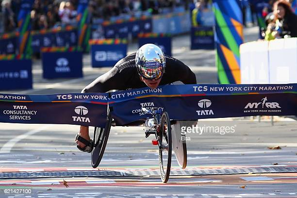 Marcel Hug of Switzerland crosses the finish line to finish first in the Pro Wheelchair Men's event during the 2016 TCS New York City Marathon in...