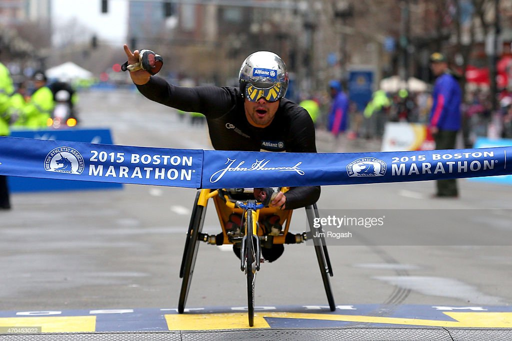Marcel Hug of Switzerland crosses the finish line to win the men's push rim wheelchair division of the 119th Boston Marathon on April 20, 2015 in Boston, Massachusetts.