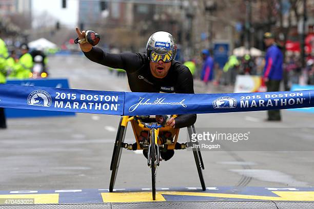 Marcel Hug of Switzerland crosses the finish line to win the men's push rim wheelchair division of the 119th Boston Marathon on April 20 2015 in...