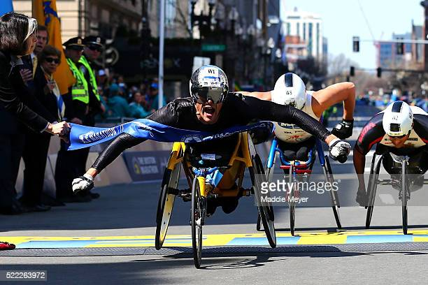 Marcel Hug of Switzerland crosses the finish line to win the men's push rim wheelchair race during the 120th Boston Marathon on April 18 2016 in...