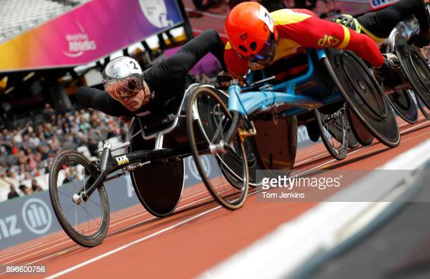 Marcel Hug of Switzerland overtakes Jorge Madera of Spain in the 1st heat in the men's 5000m T54 heats during the World Para Athletics Championships...