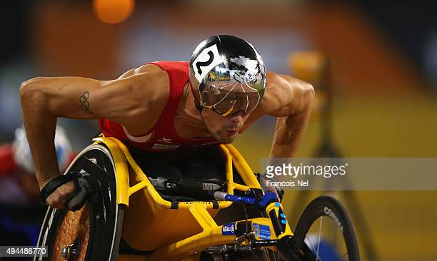 Marcel Hug of Switzerland races in the men's 400m T54 final during the Evening Session on Day Six of the IPC Athletics World Championships at Suhaim...