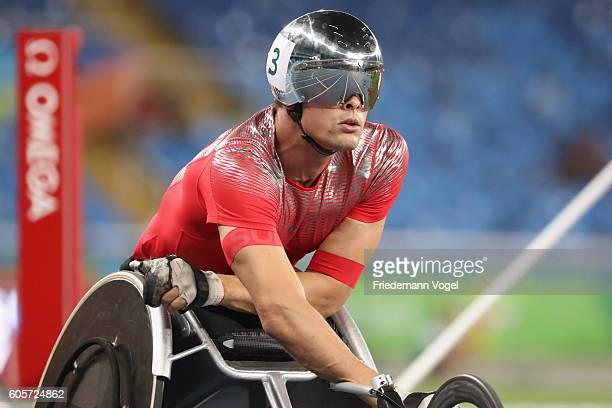 Marcel Hug of Switzerland reacts after competing in the Men's 800m T54 Heat on day 7 of the Rio 2016 Paralympic Games at the Olympic Stadium on...