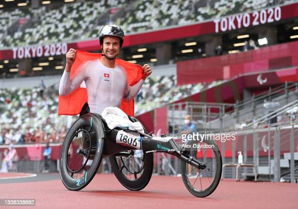 Marcel Hug of Team Switzerland reacts after winning the gold medal in the men's Marathon - T54 on day 12 of the Tokyo 2020 Paralympic Games at...