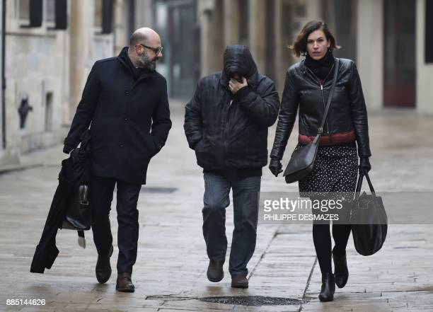 Marcel Jacob arrives with his lawyers Stephane Giuranna and Laure IognaPrat at the courthouse in Dijon central eastern France on December 4 prior to...