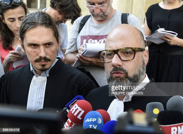 Marcel Jacob's lawyer Stephane Giuranna and Jacqueline Jacob's lawyer Gary Lagardette speak to journalists at Dijon's courthouse, on June 20 prior to...