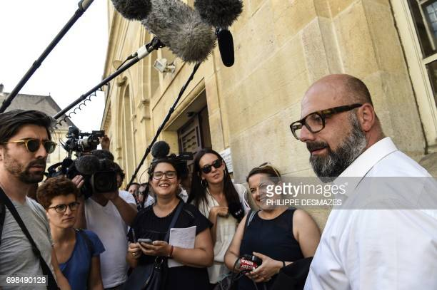 Marcel Jacob's lawyer Stephane Giuranna speaks to journalists at Dijon's courthouse, on June 20 prior to a hearing as part of the case of the 1984...