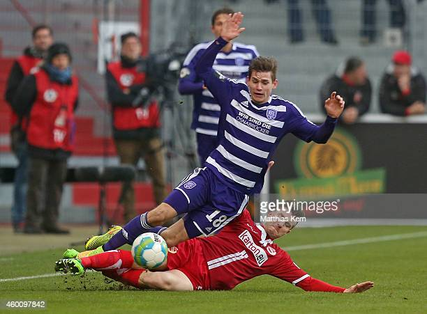 Marcel Kandziora of Osnabrueck battles for the ball with Rok Elsner of Cottbus during the third league match between FC Energie Cottbus and VFL...
