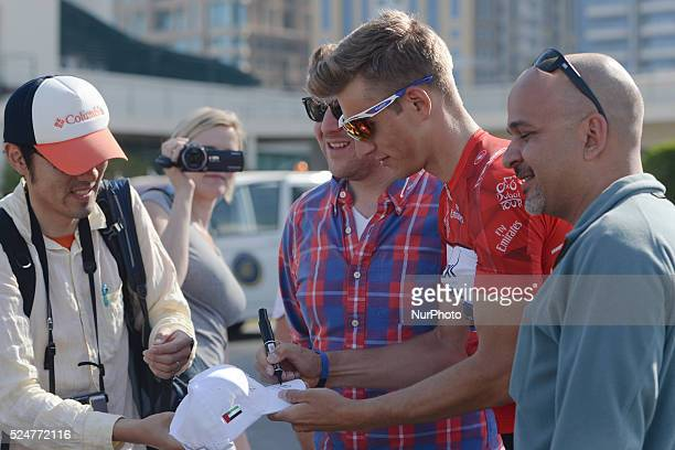 Marcel Kittel from EtixxQuickStep Team signs autographs to his fan ahead of the third stage of the 2016 Tour of Dubai the 172km The Westin Stage from...