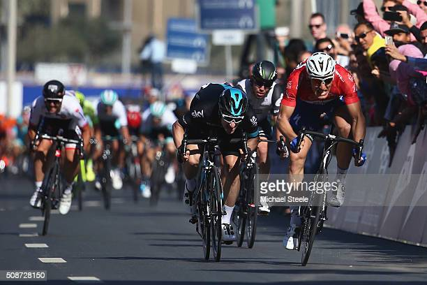 Marcel Kittel of Germany and Etixx Quick Step celebrates the stage win and overall victory from Elia Viviani of Italy and Team Sky during the...