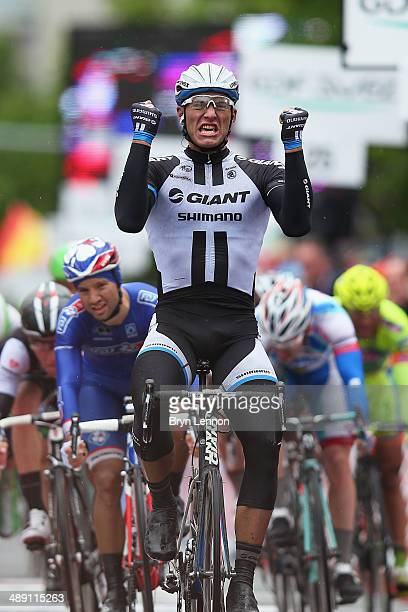 Marcel Kittel of Germany and GiantShimano celebrates crossing the finish line to win the second stage of the 2014 Giro d'Italia a 219km flat road...