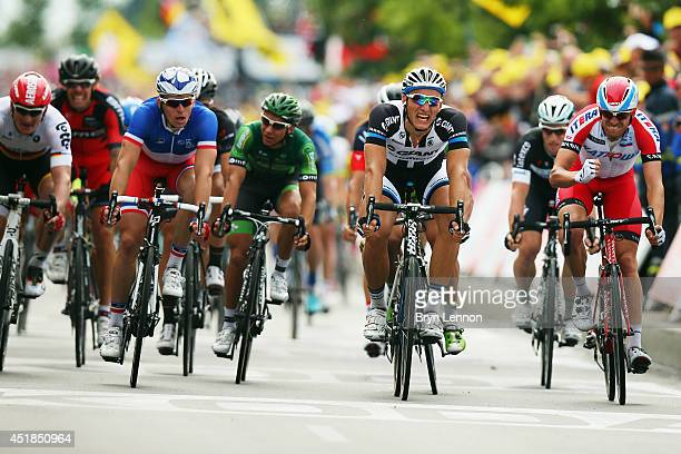 Marcel Kittel of Germany and GiantShimano crosses the line to win the fourth stage of the 2014 Tour de France a 163km stage between Le...